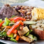 Steak, calico baked beans, corn, fresh green salad, garlic bread, peach cobbler